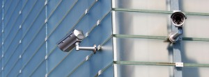 CCTV cameras on sides of commercial building