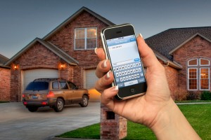 Woman using smart phone to control home security system